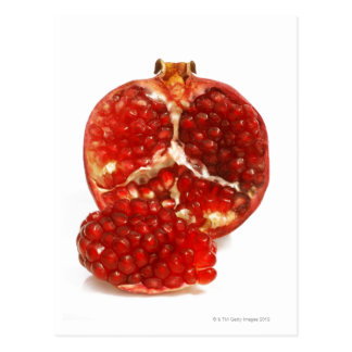 Half a ripe pomegranate cut to expose the juicy postcard