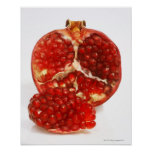 Half a ripe pomegranate cut to expose the juicy poster