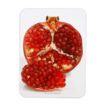 Half a ripe pomegranate cut to expose the juicy rectangle magnet