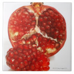 Half a ripe pomegranate cut to expose the juicy tile