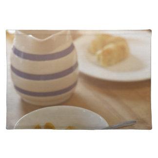 Half eaten breakfast on kitchen table placemat