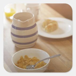 Half eaten breakfast on kitchen table square sticker