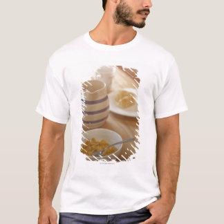 Half eaten breakfast on kitchen table T-Shirt