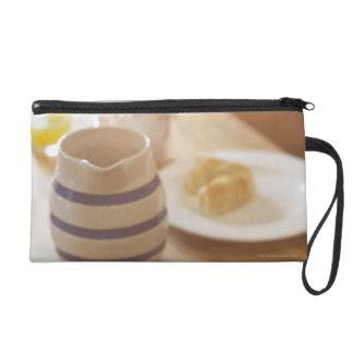 Half eaten breakfast on kitchen table wristlet purse