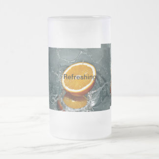 Half orange drenching in water frosted glass beer mug
