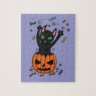 Halloween Black cat jumping out of a pumpkin Jigsaw Puzzles