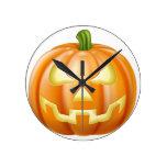 Halloween carved pumpkin clock