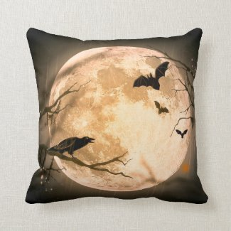 Halloween cushion with spooky moonlit sky.