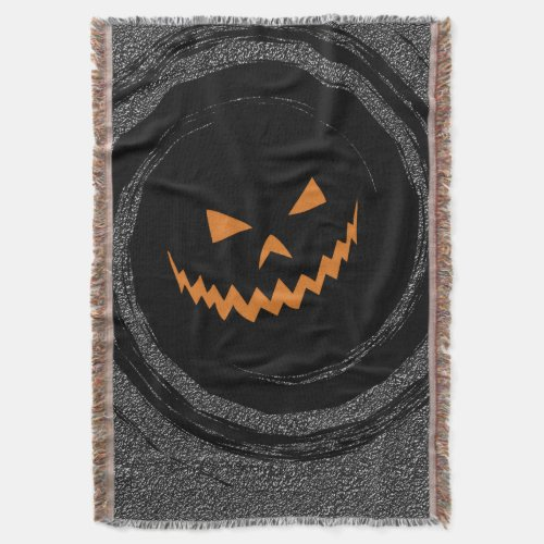 Halloween Glowing Jack O'Lantern in a black swirl Throw Blanket