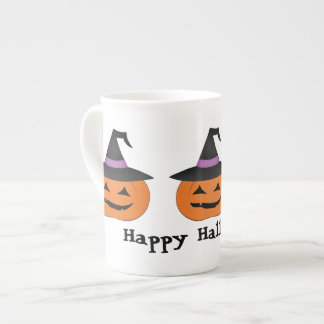 Halloween jack o lantern with witch hat tea cup
