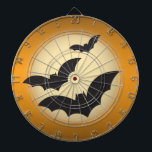 """Halloween moon with bats dartboard<br><div class=""""desc"""">This dart board has a dark orange background with the moon in the center and three bats flying in front of the moon.</div>"""