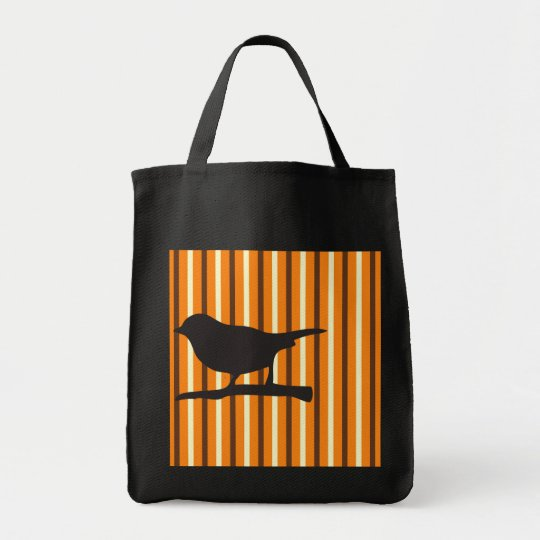 Halloween orange raven bird & branch silhouette tote bag
