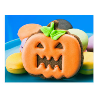 Halloween pumpkin and colorful cookies postcard