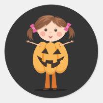 Halloween pumpkin girl on dark background round sticker