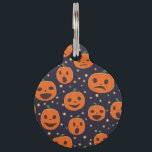 """Halloween Pumpkin Pattern Jack-o-Lantern Festive Pet Name Tag<br><div class=""""desc"""">Adorably spooky carved pumpkin, jack-o-lantern, pattern. The little orange pumpkin faces have different expressions from happy to surprised on a black background with little yellow dashes of color in between. Fun and festive pet tag for you buddy to wear during the Halloween season! Check out my store for more cool...</div>"""