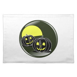 Halloween pumpkins in front of a yellow moon place mat