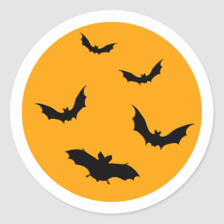Halloween sticker with moon and flying bats