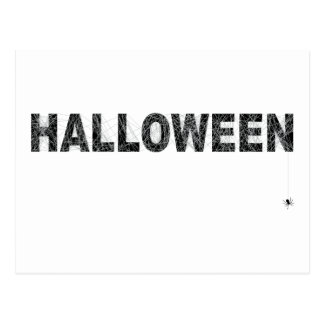 Halloween text design with spider net postcard