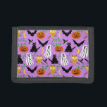 """Halloween Theme Collage Toss Pattern Purple Trifold Wallet<br><div class=""""desc"""">This whimsical Halloween toss pattern is made mostly in orange and black on a light purple background. It includes white ghosts, black cats and bats, orange pumpkins and light-orange owls. It&#39;s a cute cartoon design to help you celebrate at your spooky party. This design is appropriate for a kids&#39; party...</div>"""