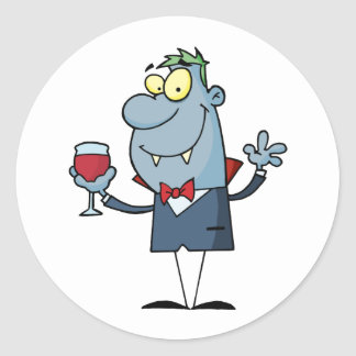 Halloween vampire with a glass classic round sticker