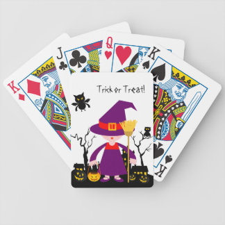 Halloween witch kid goes trick or treating bicycle playing cards