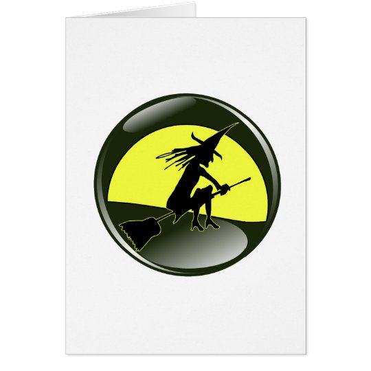 Halloween witch on broom in front of yellow moon card