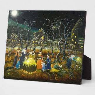 Halloween witches around the teaching cauldron plaque