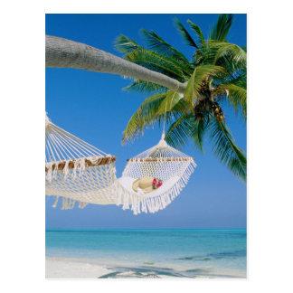 Hamaca de las vacaciones del paraíso de la playa tarjeta postal