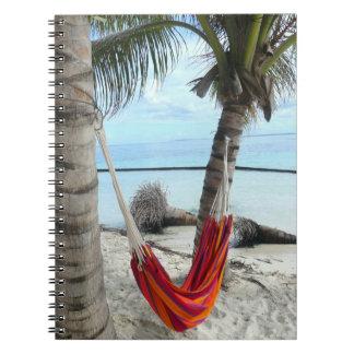 Hamaca por el cuaderno de la playa