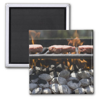 Hamburgers cooking on grill 2 inch square magnet