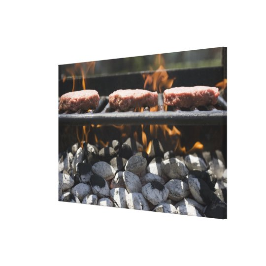Hamburgers cooking on grill canvas print