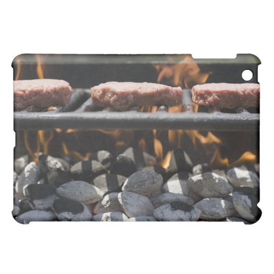 Hamburgers cooking on grill iPad mini case