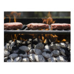 Hamburgers cooking on grill postcard