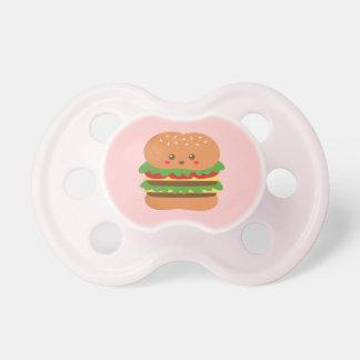 Hamburguesa grande linda y feliz, para los amantes chupetes de bebé