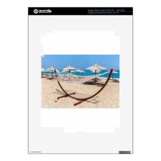 Hammock with beach umbrellas at coast iPad 3 skin