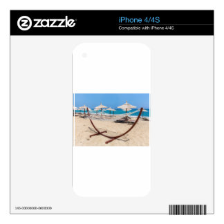 Hammock with beach umbrellas at coast skins for the iPhone 4S