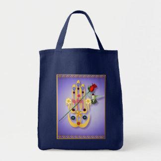 Hamsa y bolsos de las flores