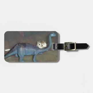 Hamster on a dinosaur luggage tag