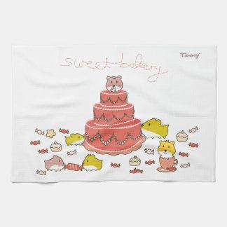 hámsteres lindos del kawaii en una torta toalla