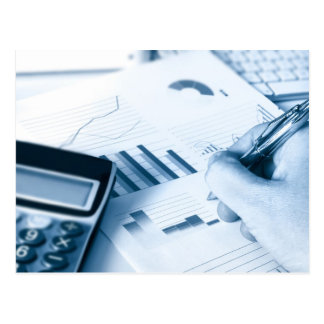 hand and pen writing amongst financial figures postcard