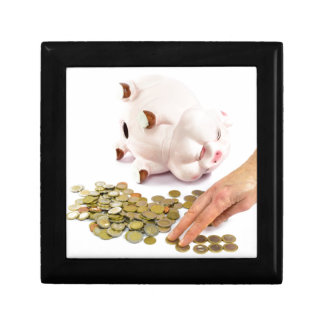 Hand counting euro coins from piggy bank keepsake box