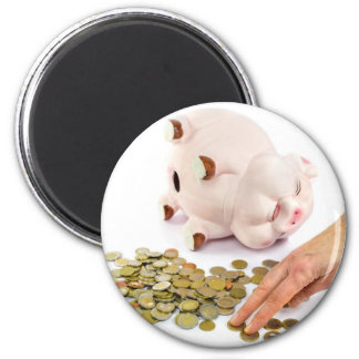 Hand counting euro coins from piggy bank magnet