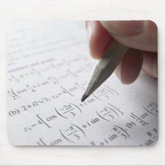 Hand doing math homework mouse pad