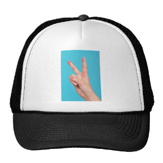 Hand  doing peace signs trucker hat