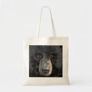Hand drawn black bear face close up tote bags