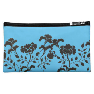 Hand drawn black flower garden on blue cosmetic bag