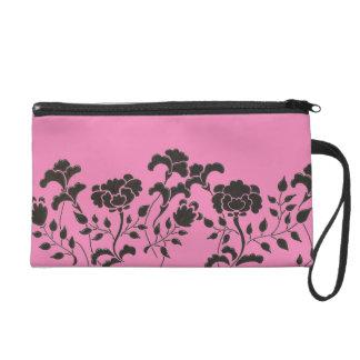 Hand drawn black flower garden on pink wristlet