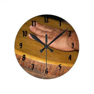 hand drum skin head with hand.jpg round clock