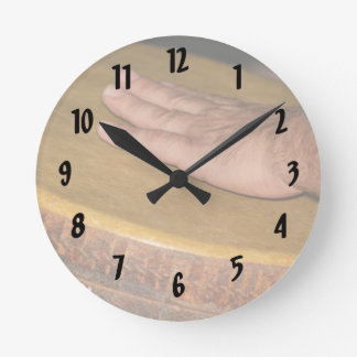 hand drum skin head with hand.jpg round clock