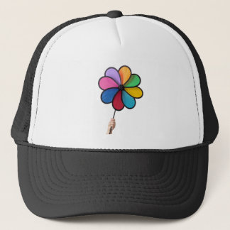 hand holding a pinwheel trucker hat